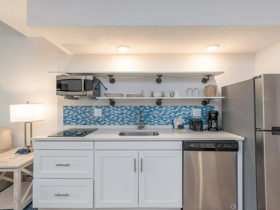 Luxury kitchen with fridge in King Suite at The Palmera Inn and Suites