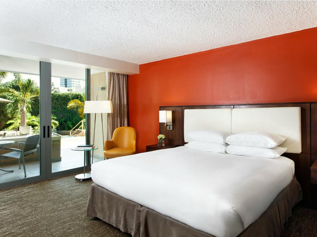 Doubletree by Hilton San Juan guestroom with and door to terrace