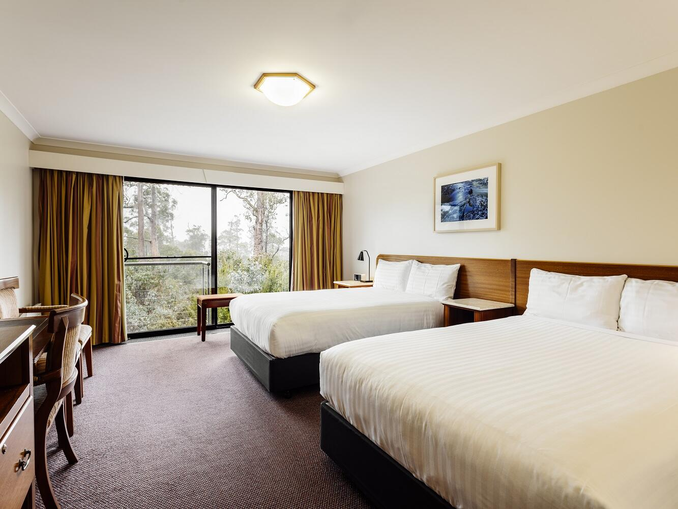 Deluxe Spa Room with two queen beds at Cradle Mountain Hotel