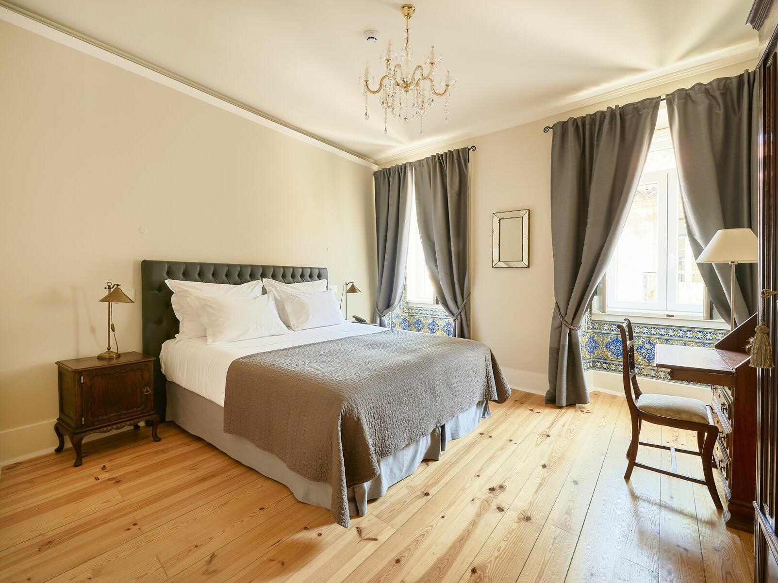 Hotel Alegria room with king bed and desk near windows