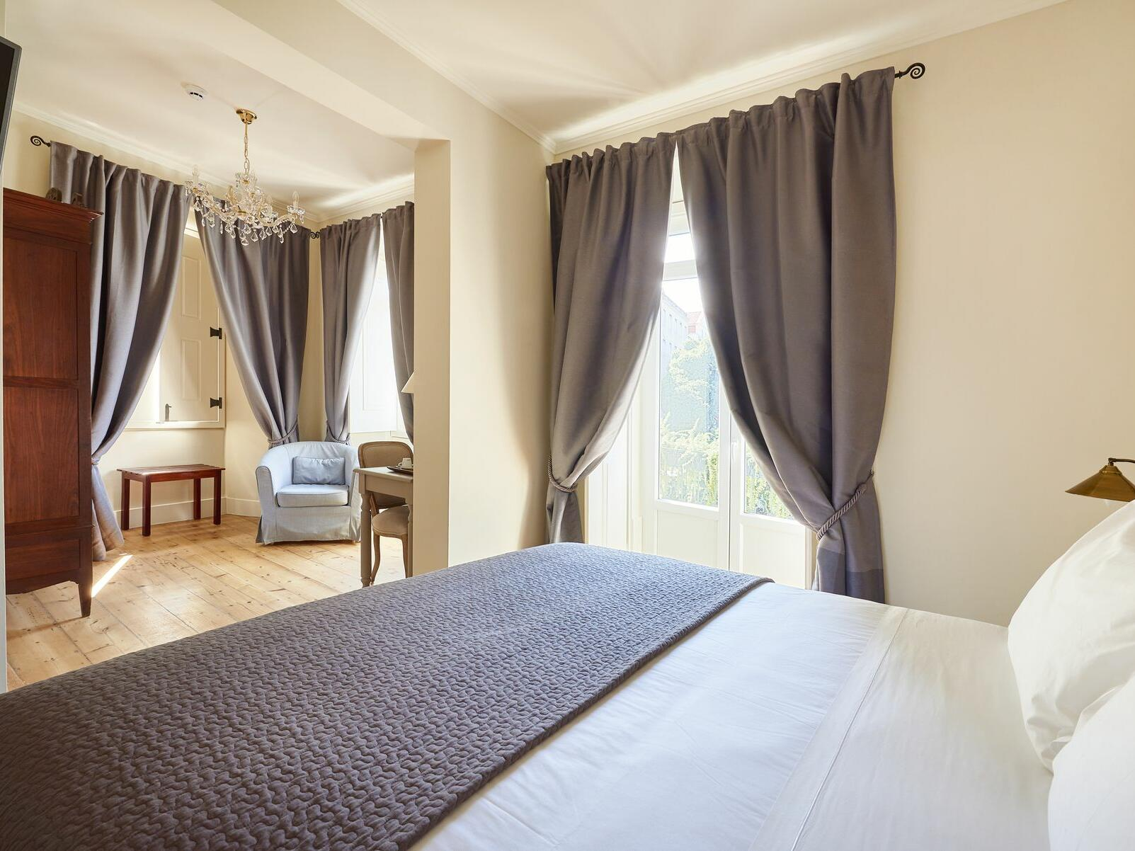 Hotel Alegria room with bed, and accent chairs near window