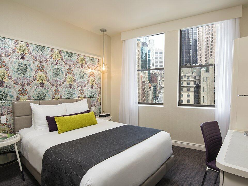 Bedroom of Gold King with a king bed at Dream Midtown NYC