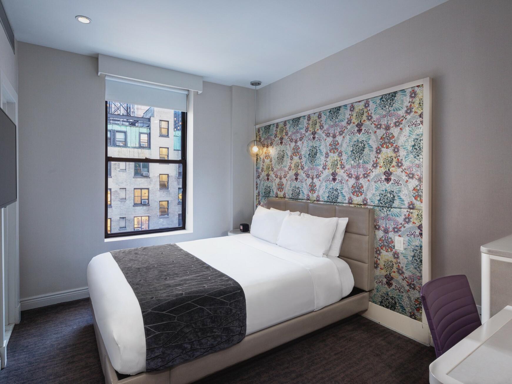 Accessible Bronze Queen Bedroom with queen bed at Dream Midtown