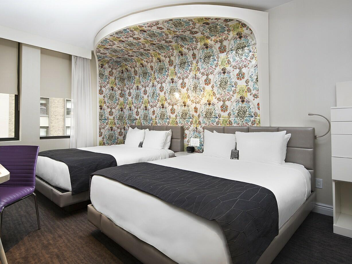 Bedroom of Silver Double with 2 full beds at Dream Midtown NYC
