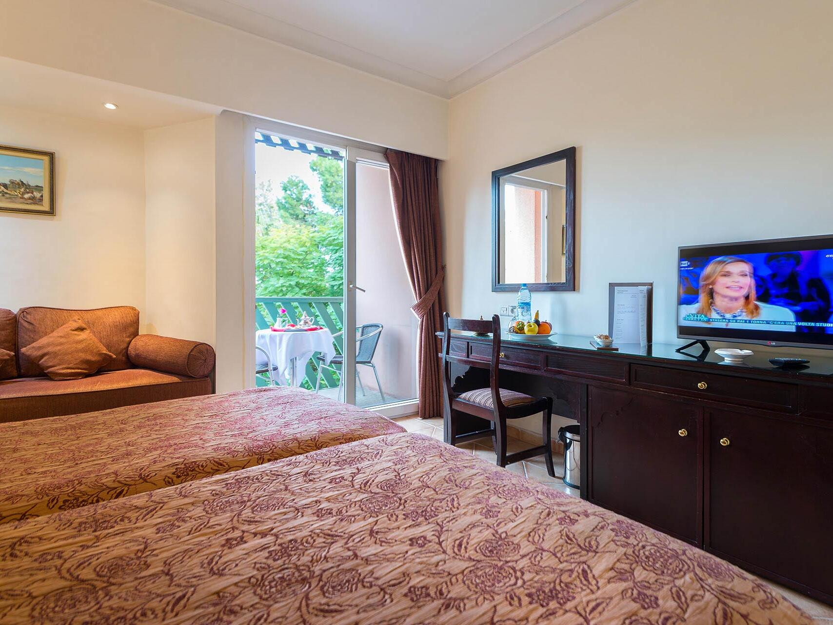 Large Bedroom with TV - Farah Marrakech Hotel