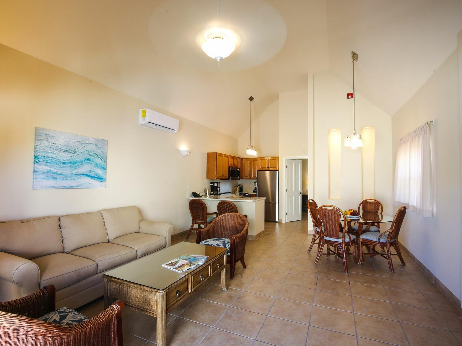 Living room of 1 Bedroom Bungalow at Windsong Resort On The Reef