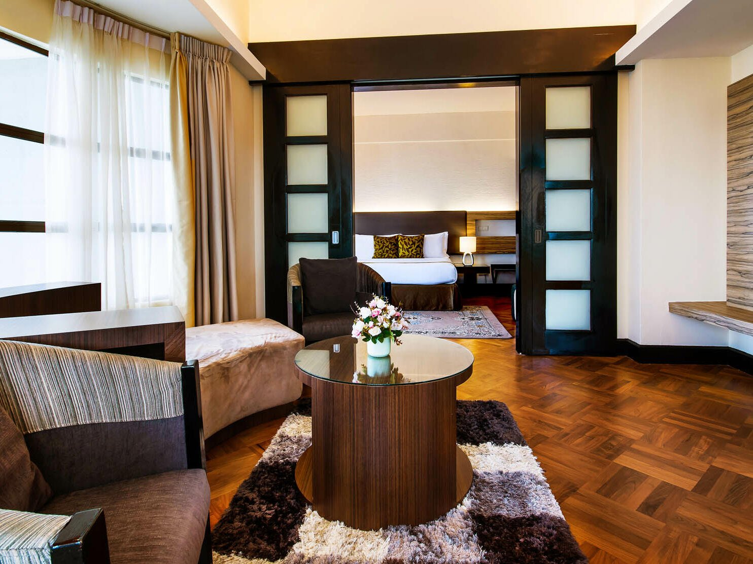 The living area of the Premium Suite with a couch and a coffee table at the Thistle Port Dickson Resort