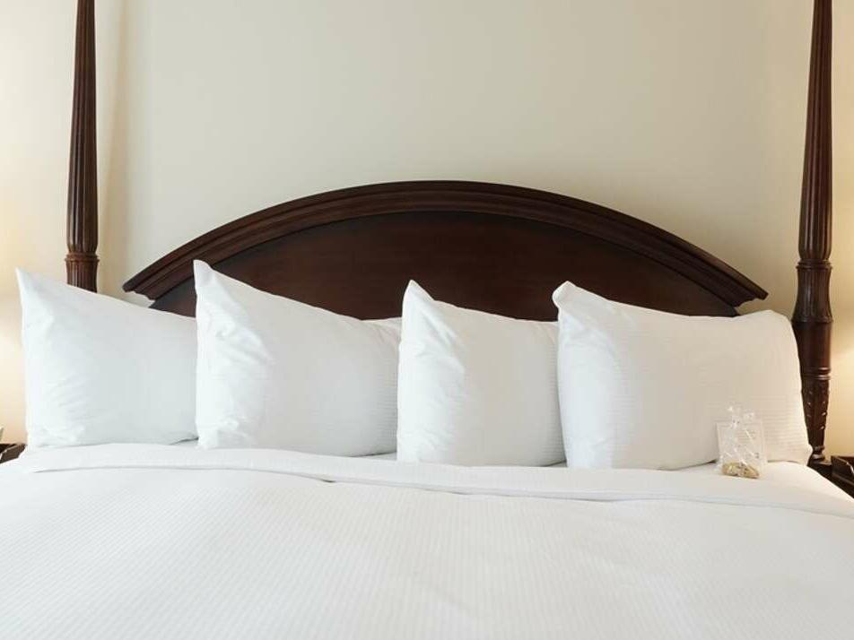 Four pillows arranged in bed view of Superior King at The Simsbury Inn