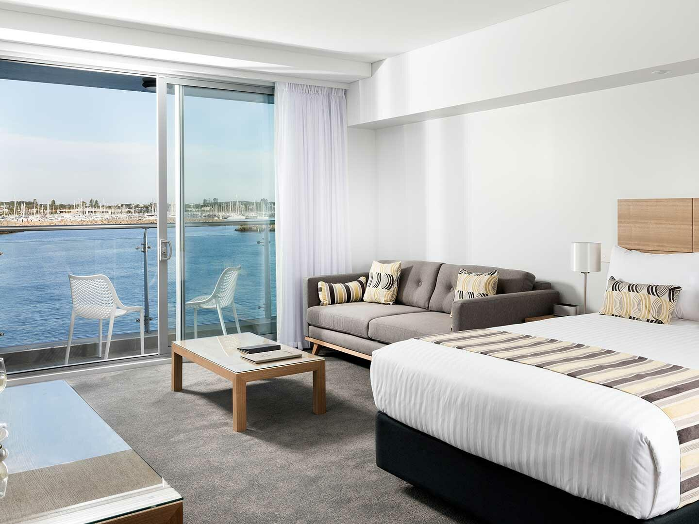 Studio Ocean Sunrise with one bed and a couch at Be Fremantle
