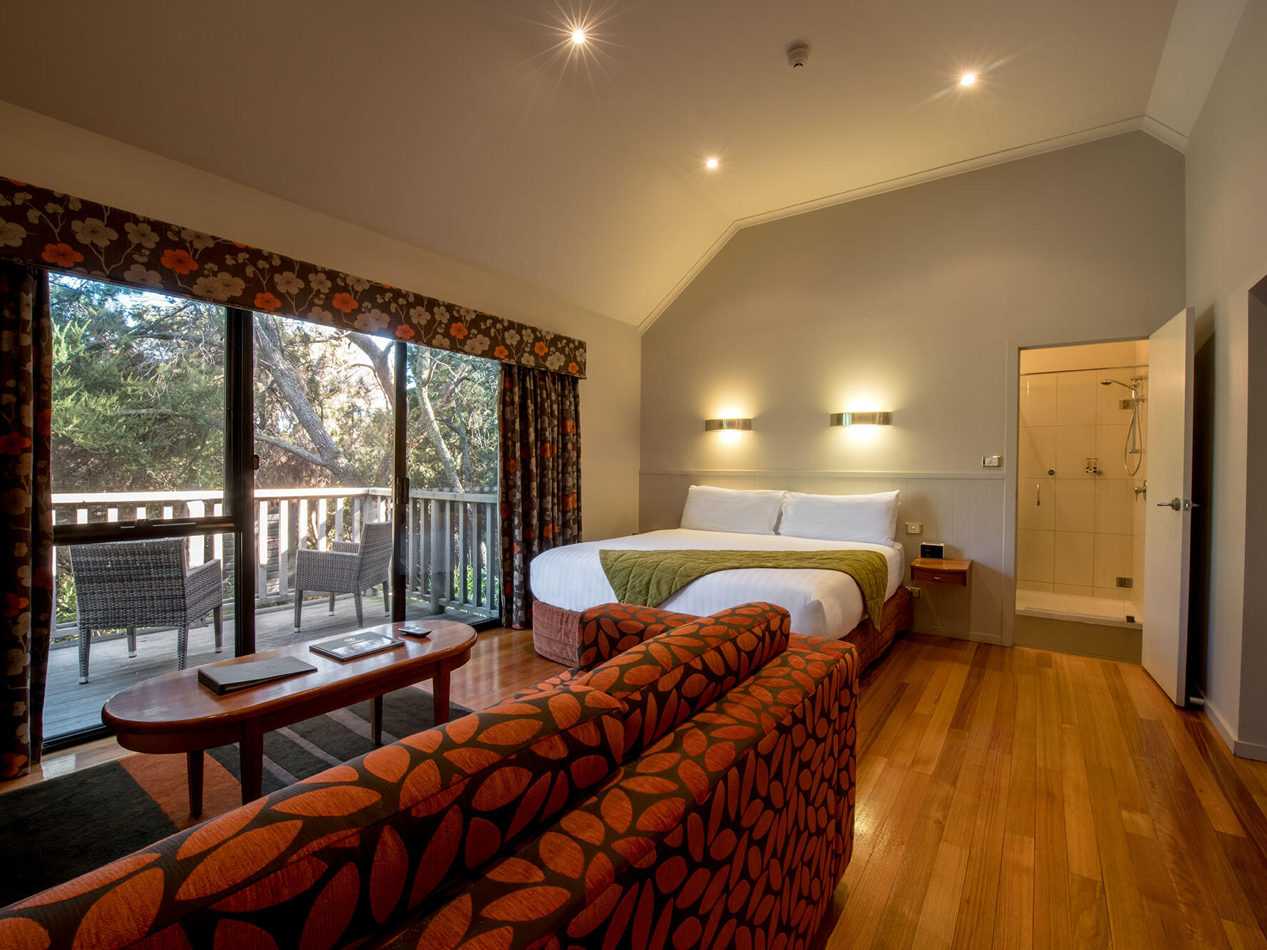 One Room Cabin bedroom with king bed & sofa at Freycinet Lodge