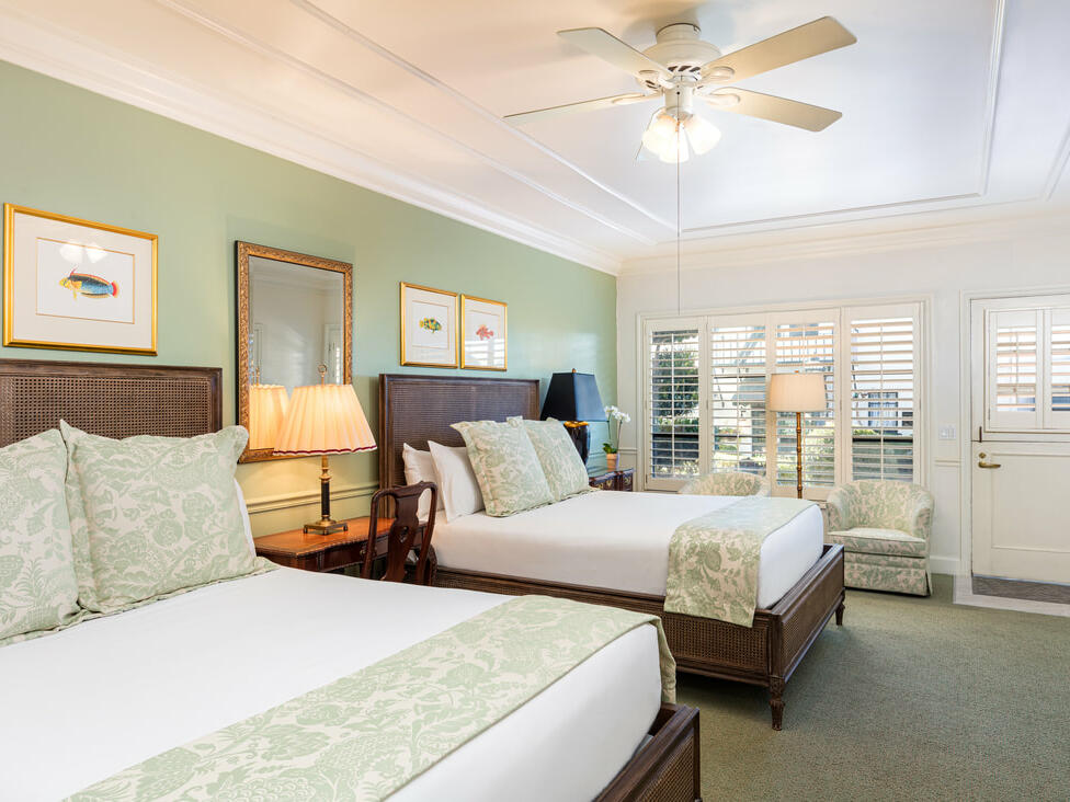 Accessible Patio Queen Room with two beds at Pine Inn