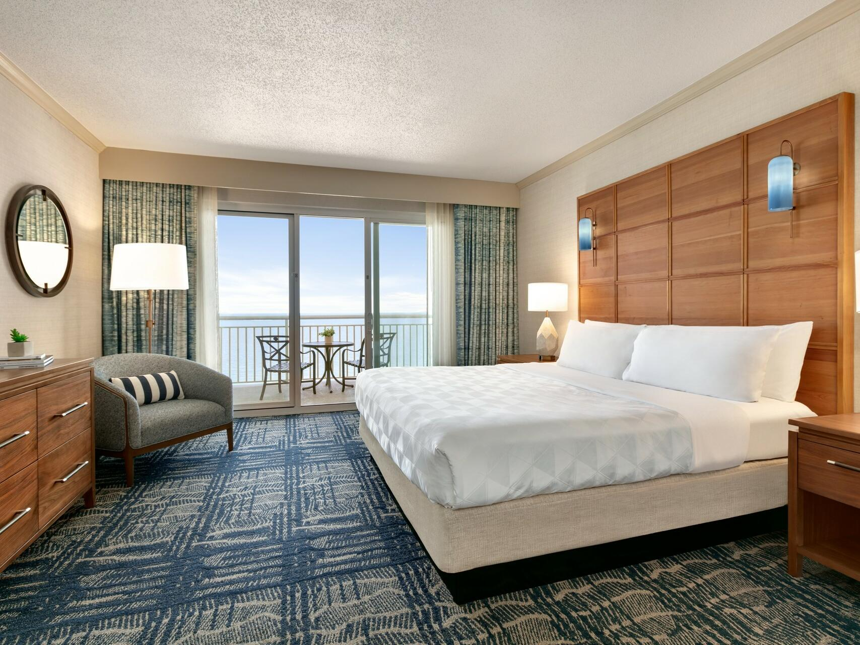 King bed in Oceanfront Suite at Holiday Inn Hotel