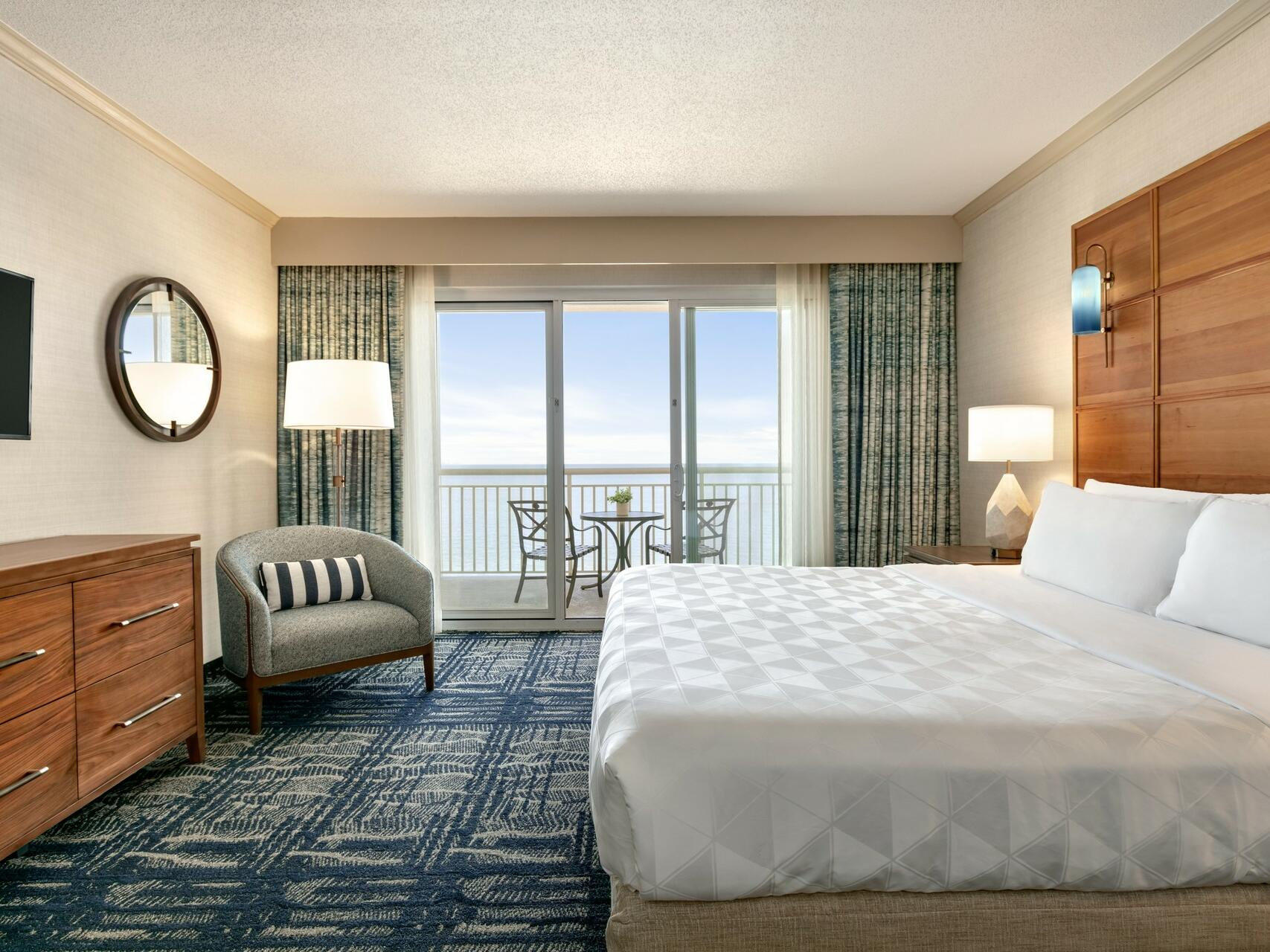 King bed with in Oceanfront Suite at Holiday Inn Hotel