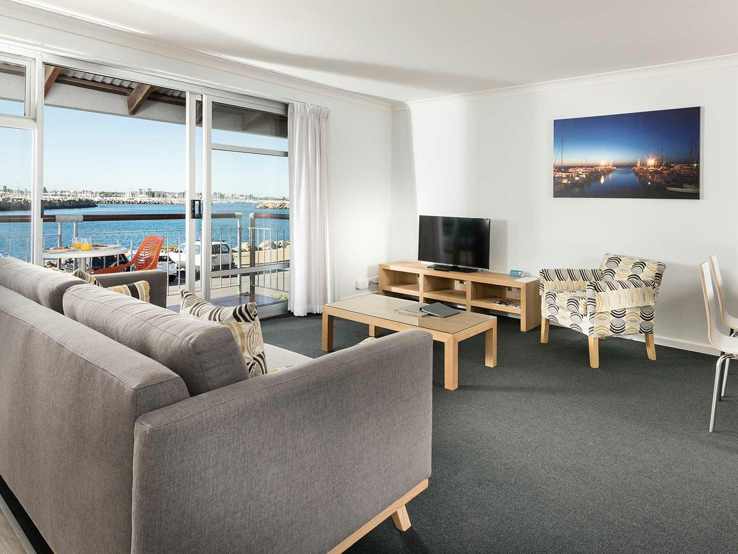 Living area in 1 Bedroom Harbour Sunrise apartment at Be Fremantle