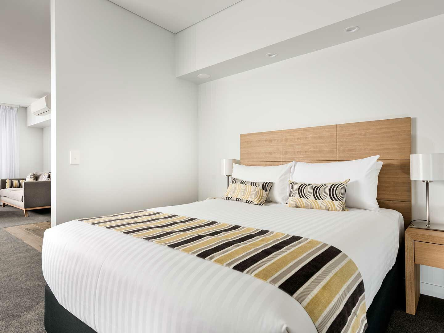 Bedroom with one bed in 1 Bedroom Ocean Sunrise apartment at Be Fremantle