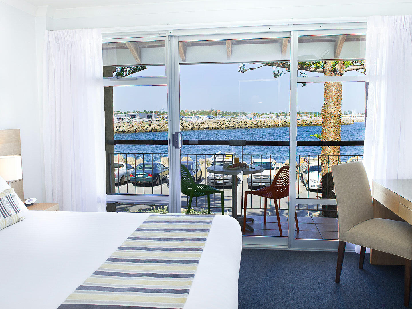 Bedroom with one bed in 2 Bedroom Harbour Sunrise apartment at Be Fremantle