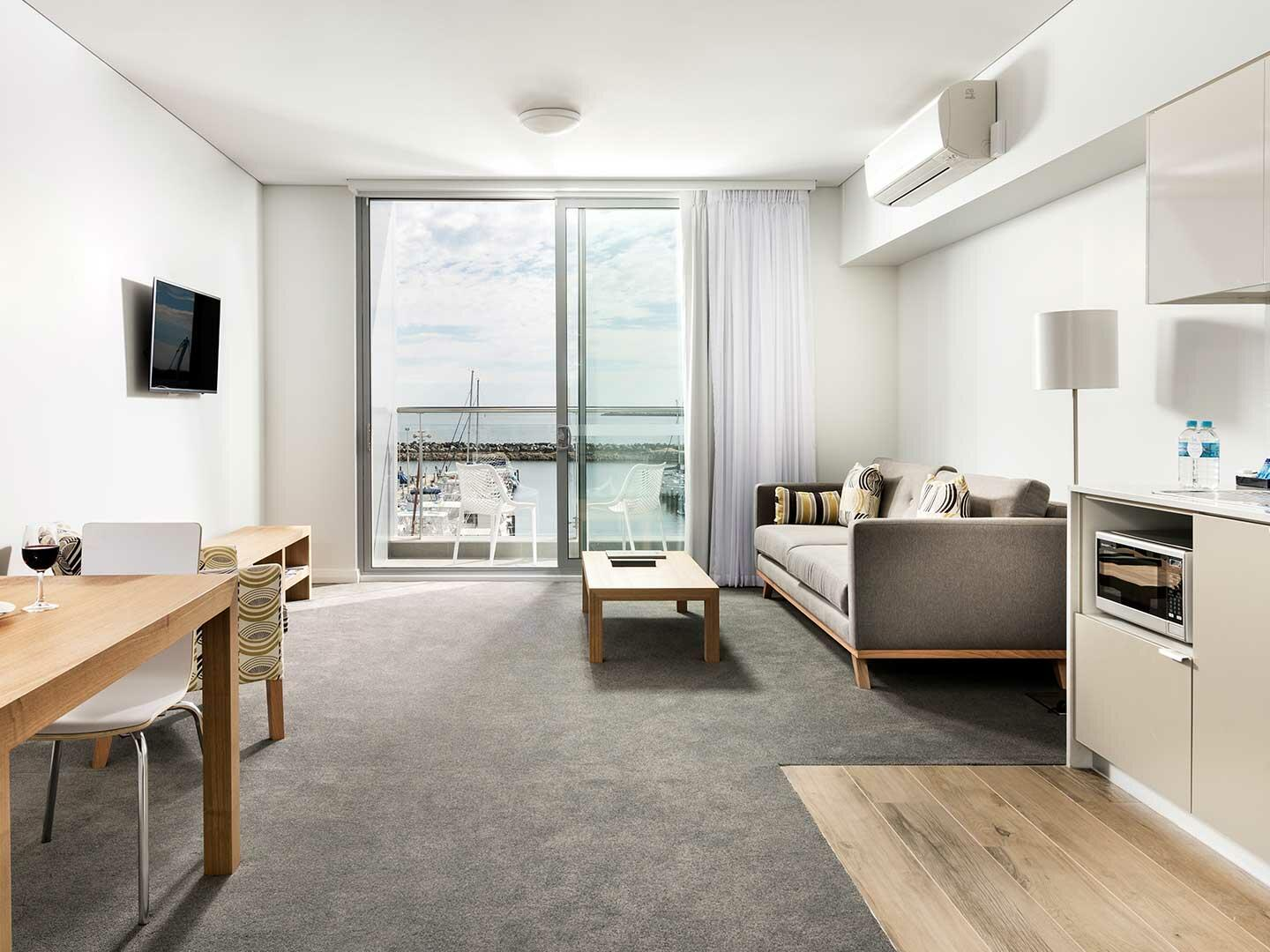 Living area and pantry area in 1 Bedroom Ocean Sunset apartment at Be Fremantle