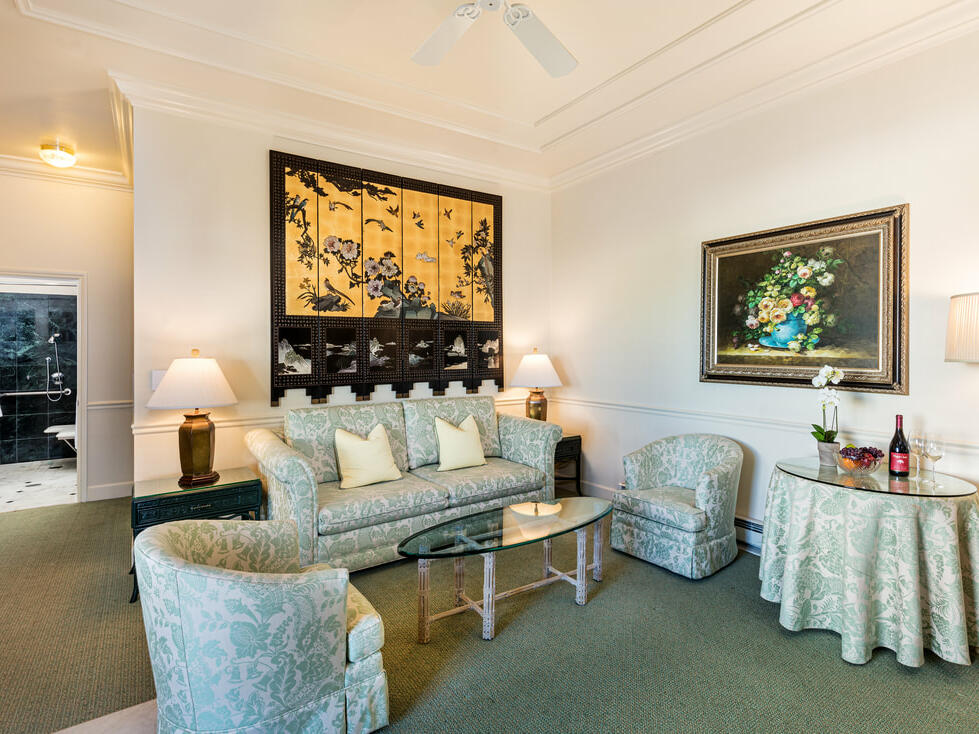 Accessible Deluxe King Suite with a sofa area at Tally Ho Inn