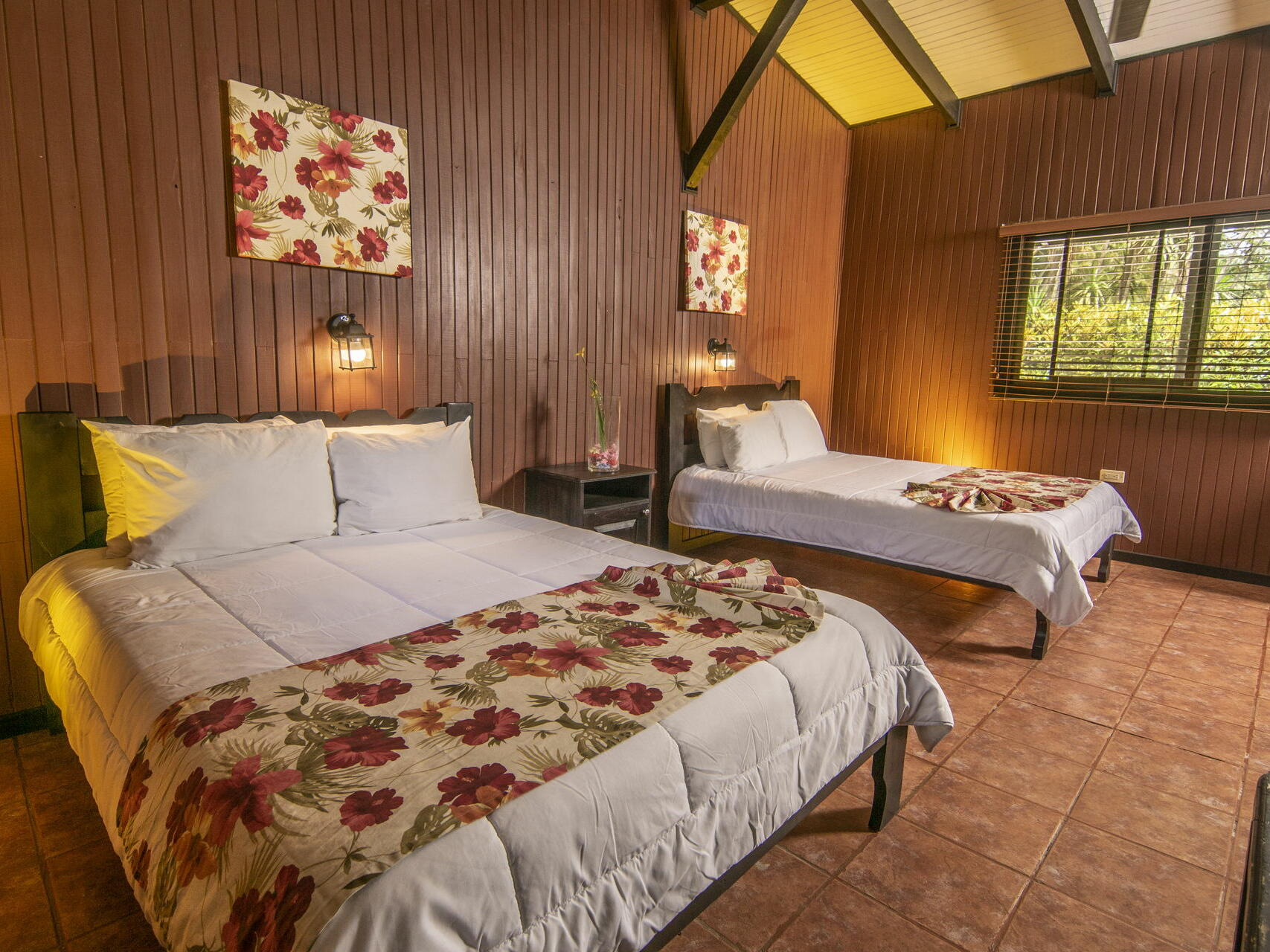 Two Beds, Wooden Wall and a Window at Buena Vista Del Rincon