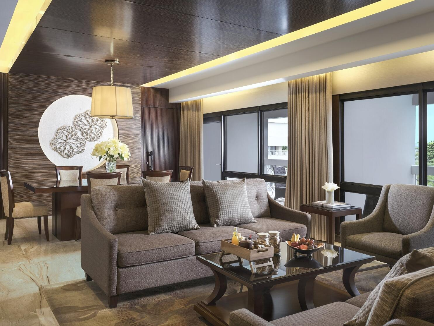 The living area in the Ambarrukmo Suite with a couch and a coffee table in Royal Ambarrukmo Yogyyakarta