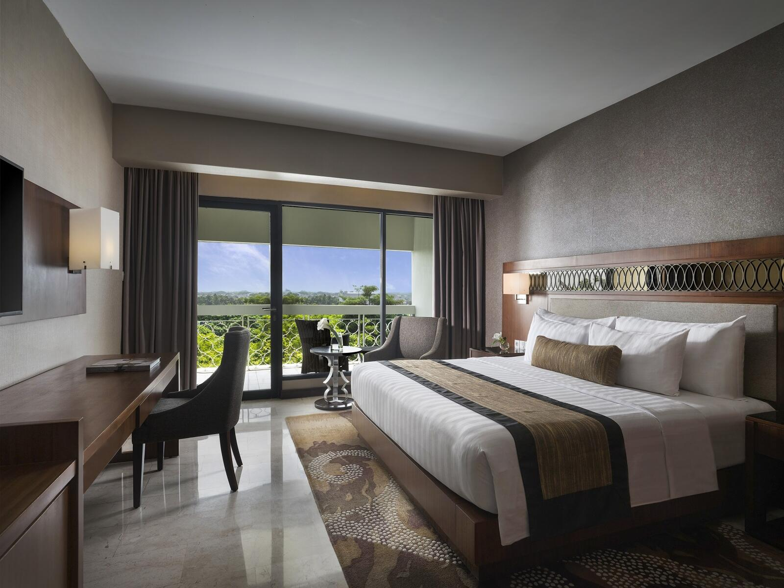 The Deluxe Room with one king bed and view in Royal Ambarrukmo Yogyyakarta
