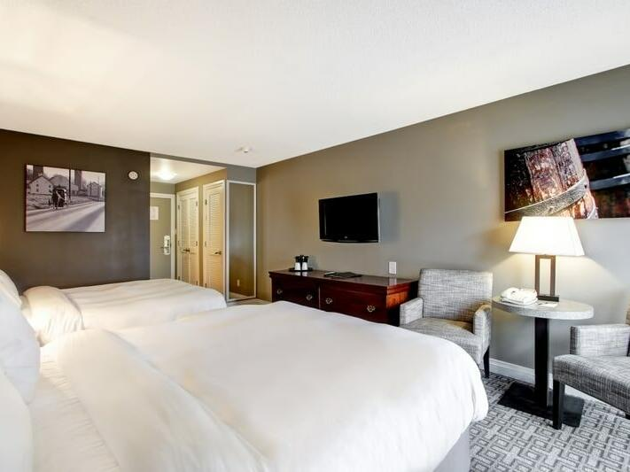 bedroom with 2 queen size bed & TV at The Inn of Waterloo