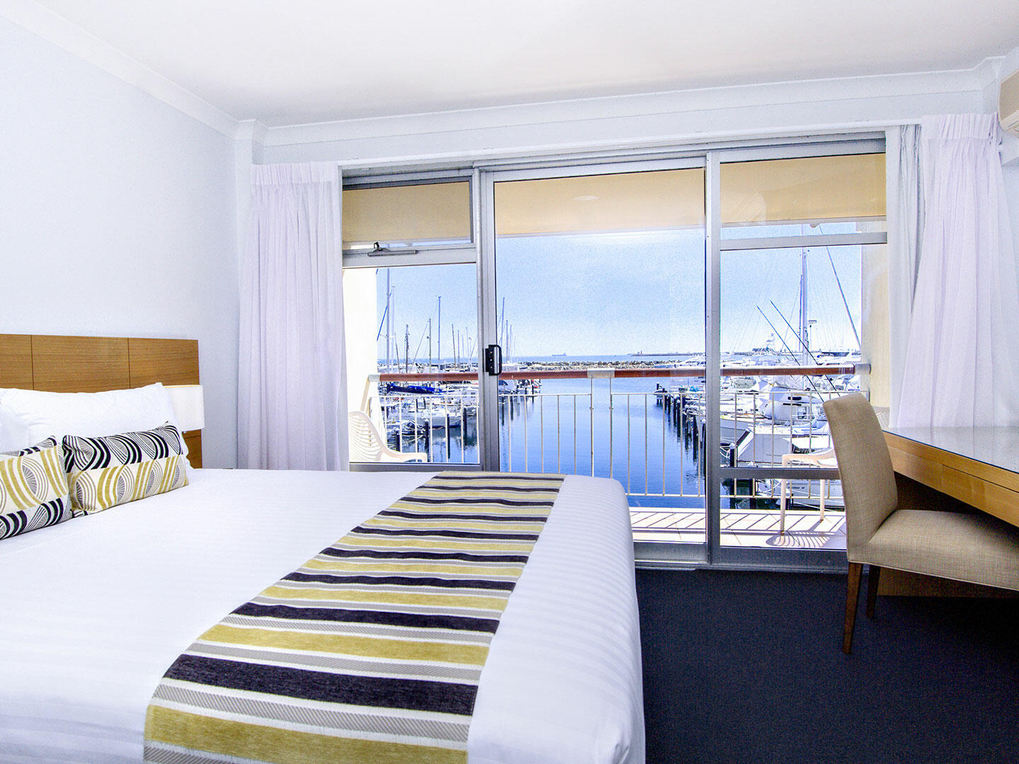 Bedroom with one bed in 2 Bedroom Ocean Sunset apartment at Be Fremantle