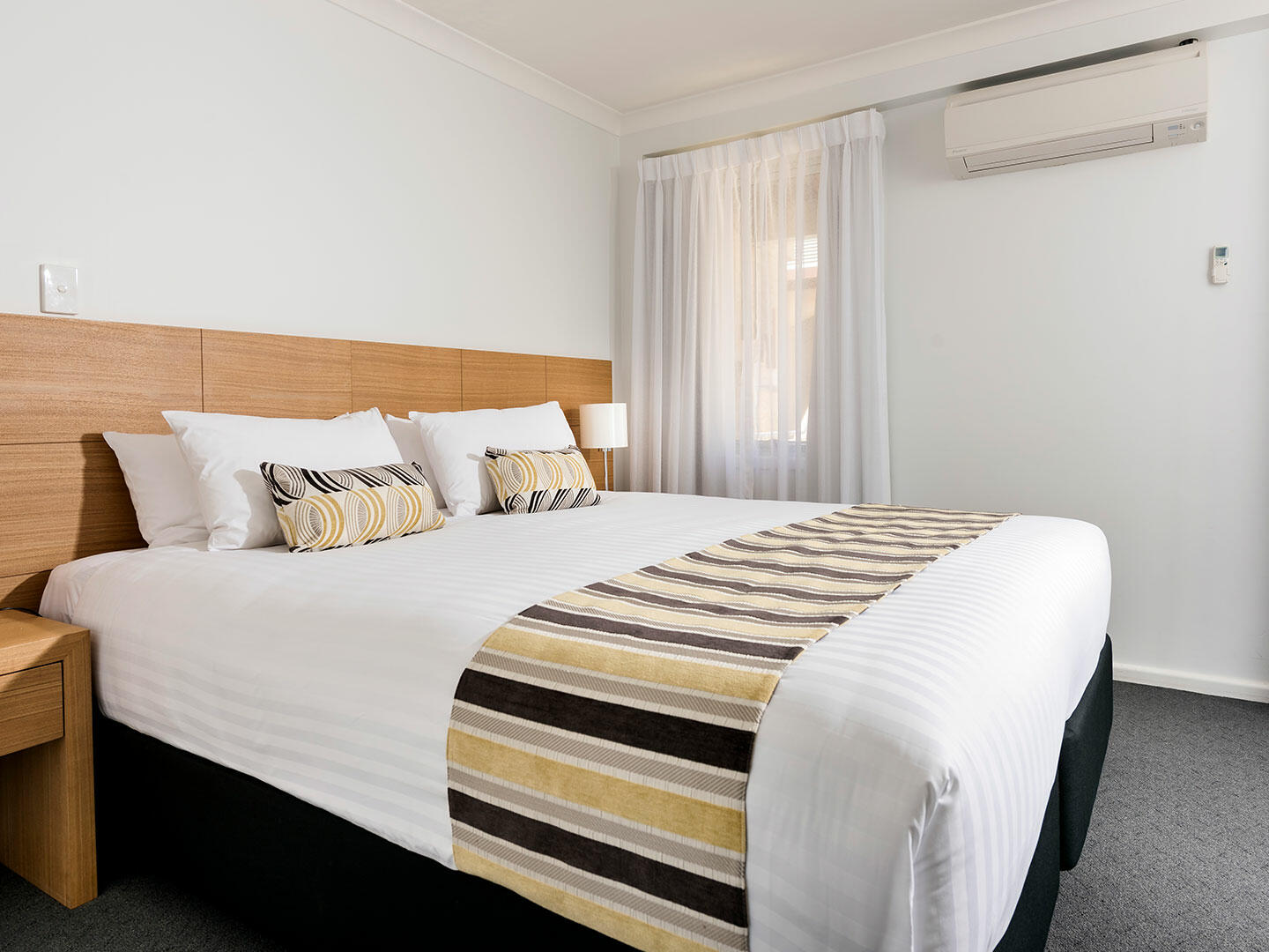 Bedroom with one bed in 2 Bedroom Ocean Sunset Spa apartment at Be Fremantle