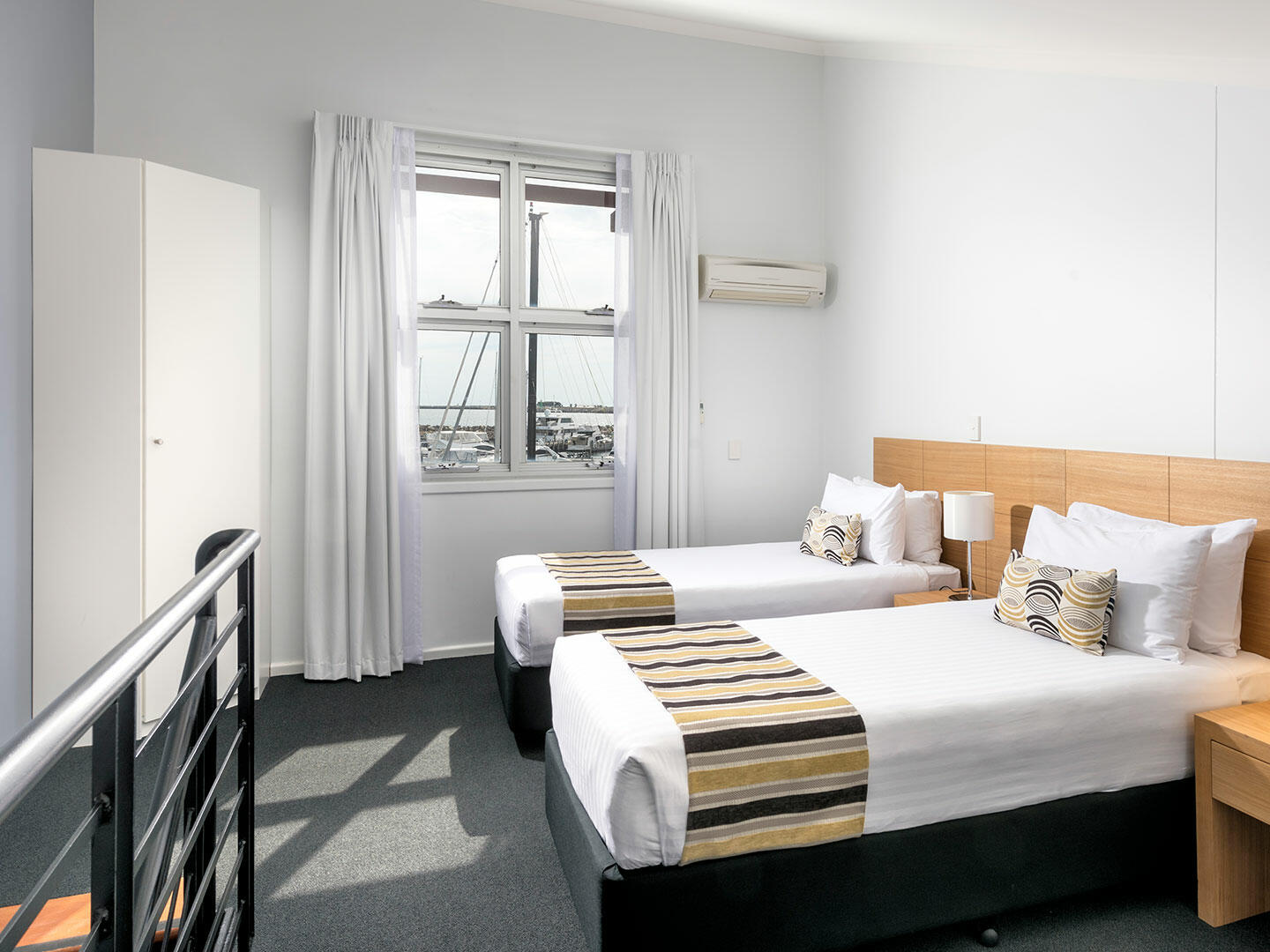 Bedroom with two beds in 3 Bedroom Ocean Sunset Spa apartment at Be Fremantle