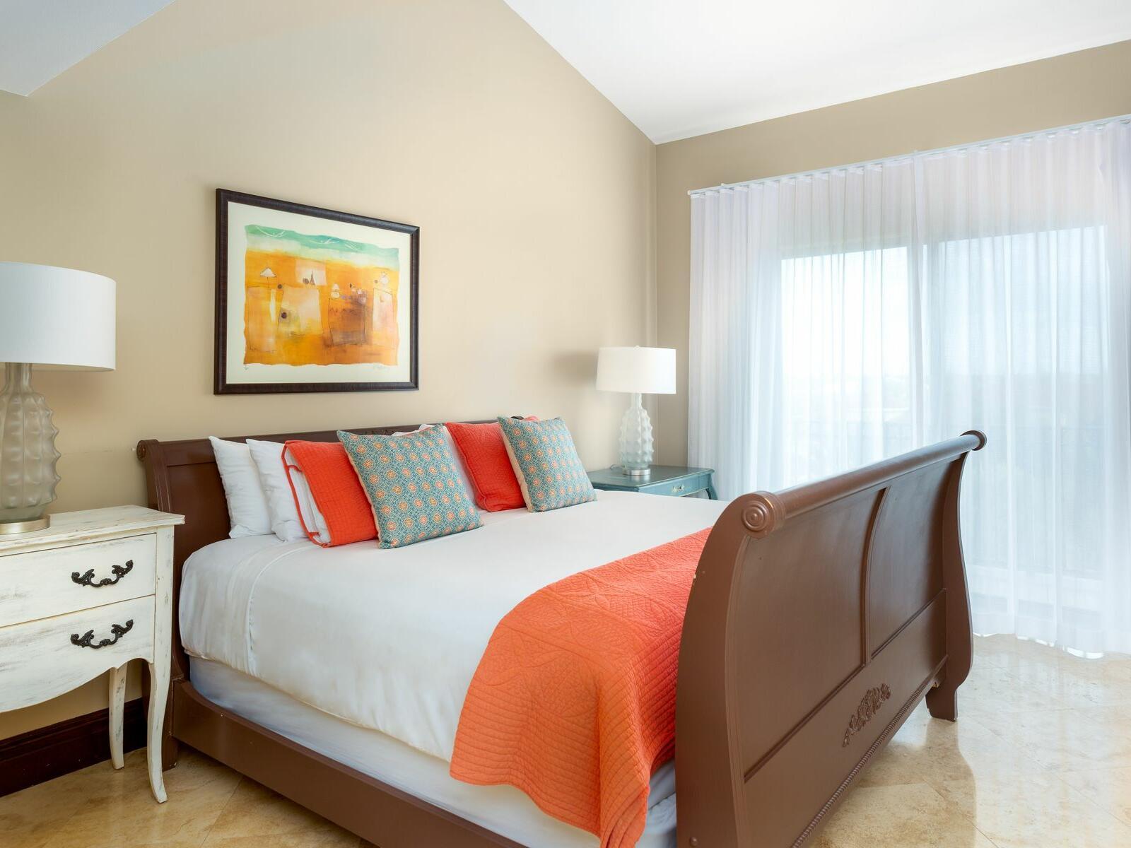 King bed in Two Bedroom Duplex Ocean room at Somerset Grace Bay