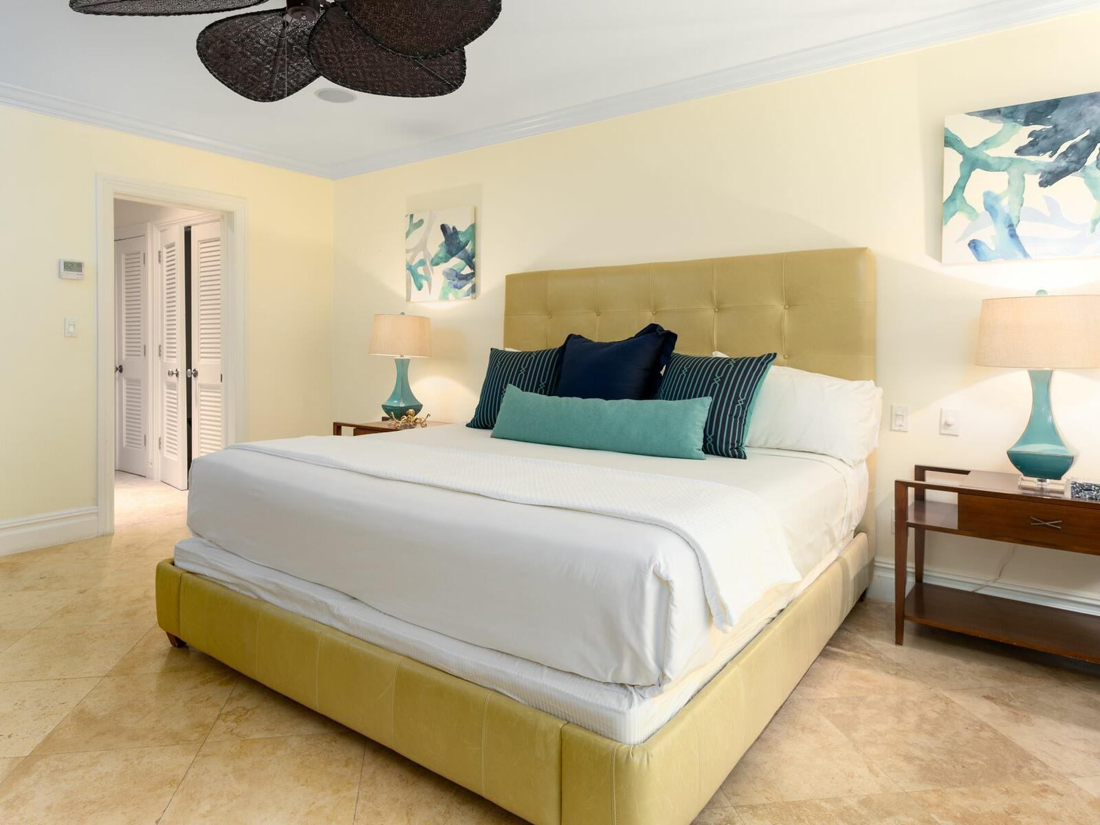 King bed in Three Bedroom Pool View room at Somerset Grace Bay