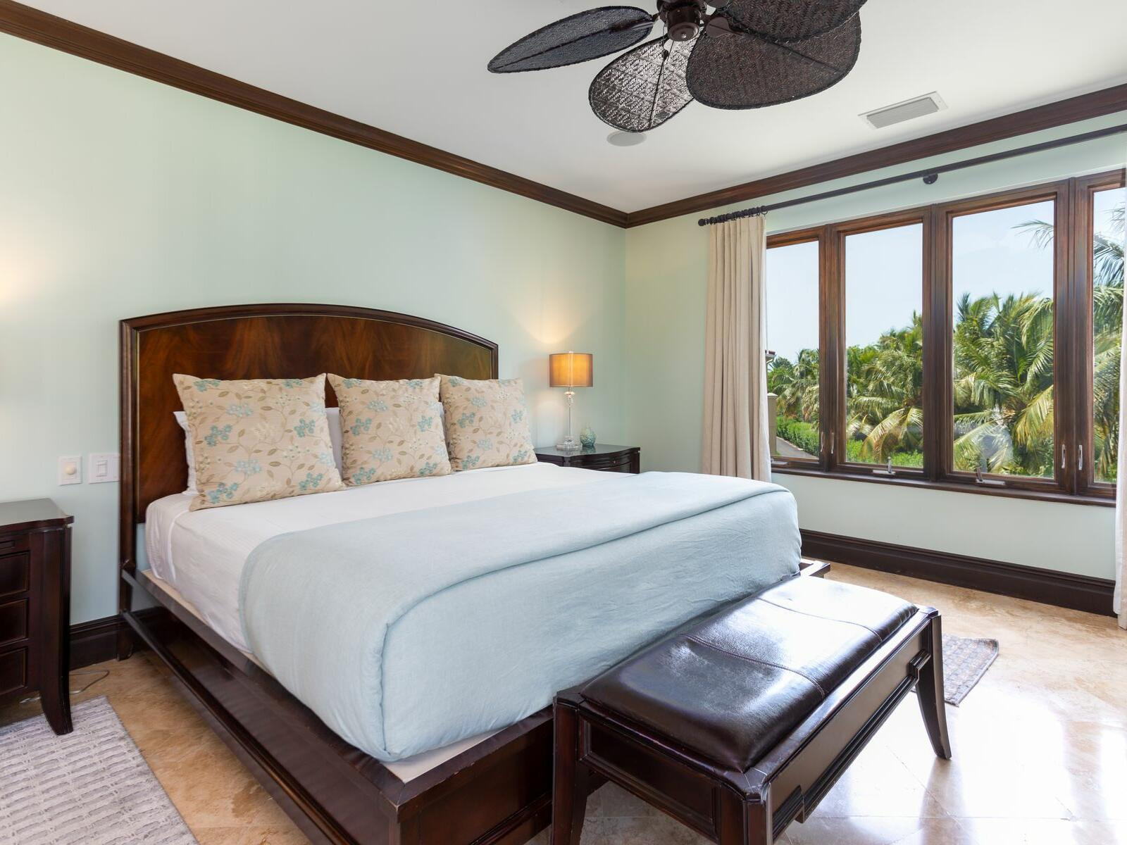 King bed in Three Bedroom Ocean View room at Somerset Grace Bay
