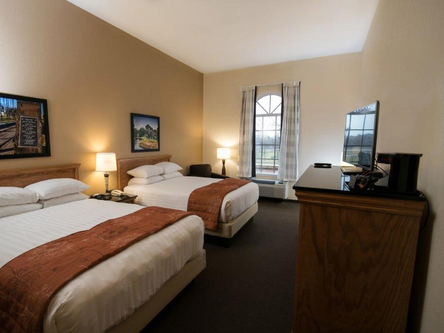 Two Double beds in Queen Mobility Tub at Marv Herzog Hotel