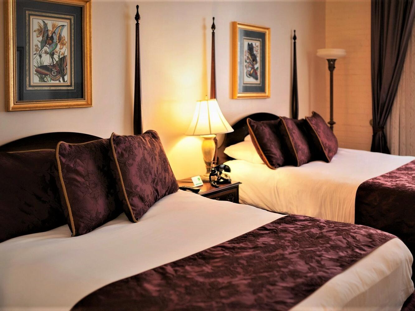 Bedroom of Double Queen Studio Suite at Hotel at Old Town