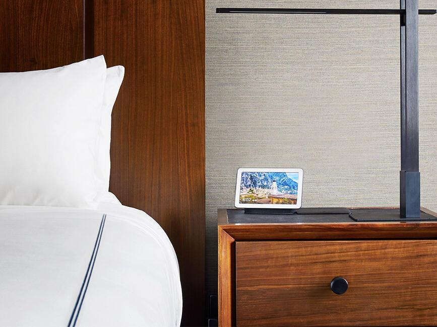 Google Nest Hub on desk next to bed