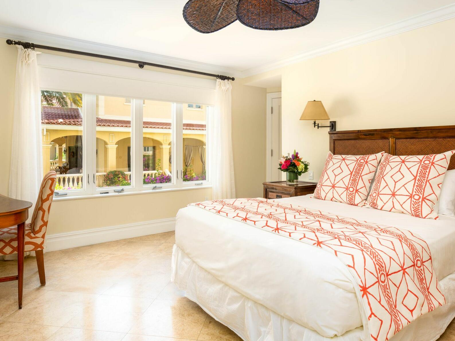 King bed in One Bedroom Pool View room at Somerset Grace Bay