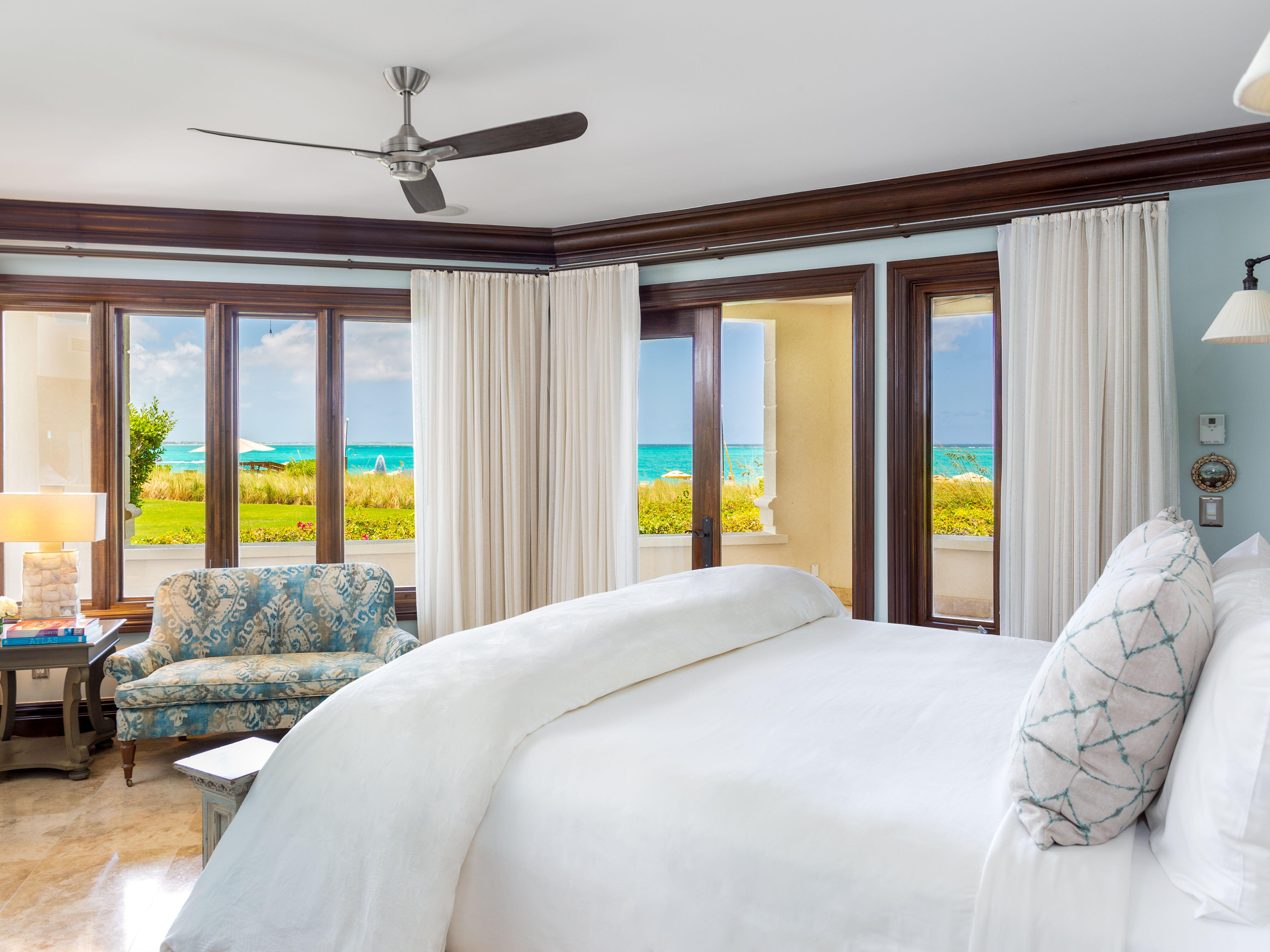 King bed in Three Bedroom Ocean Front at Somerset On Grace Bay