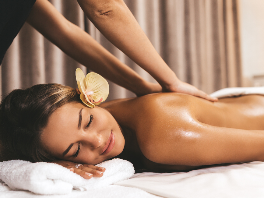 woman having back massage in spa