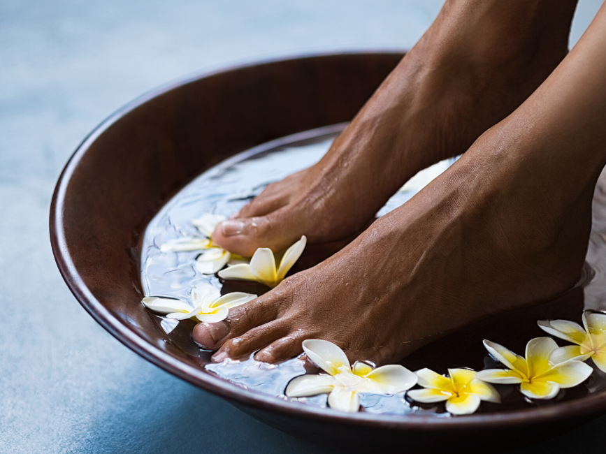 feet soaked in floral water for spa treatment