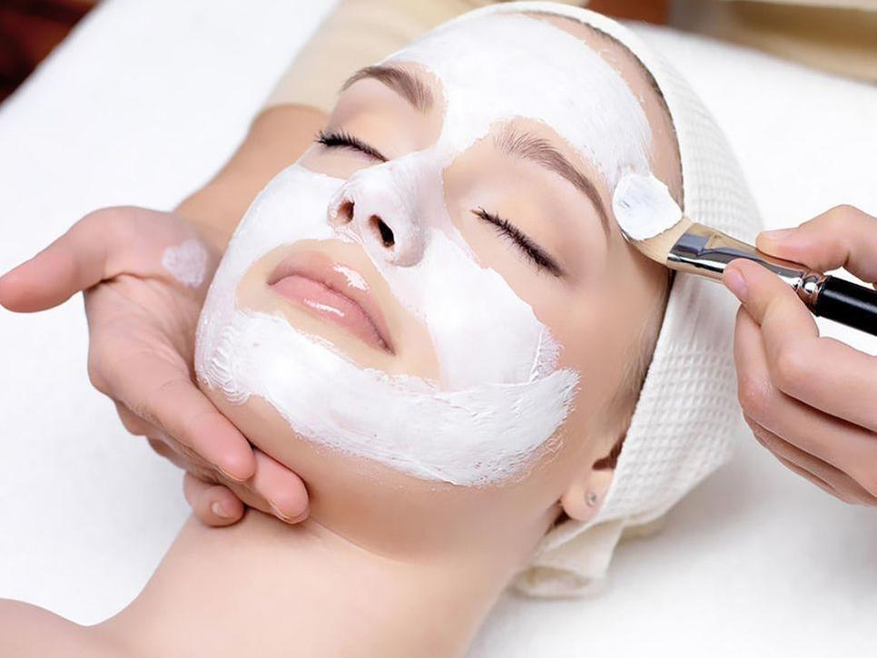 Applying products in Andean facial treatment at Hotel Sumaq