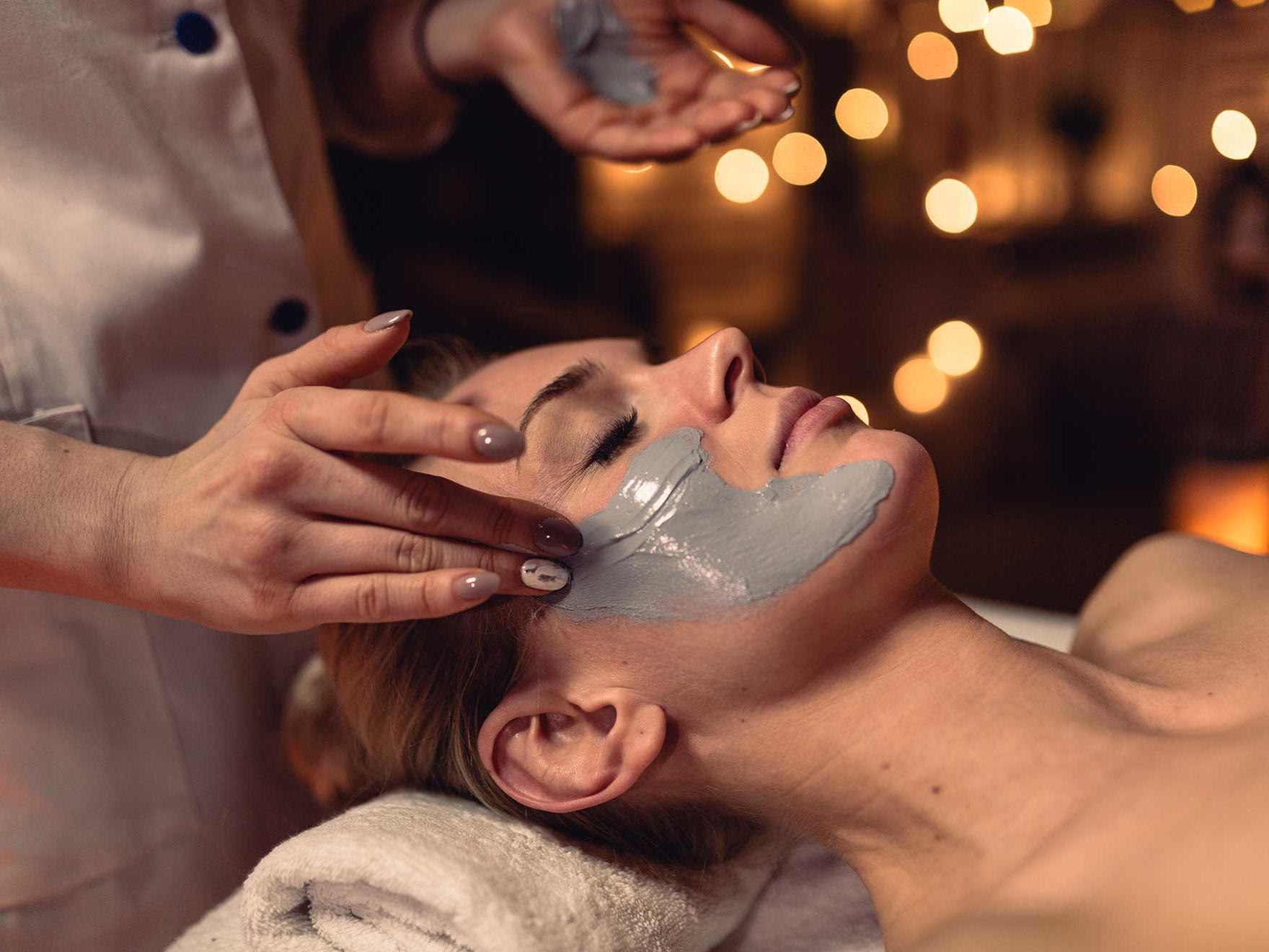 Lady applying a face mask