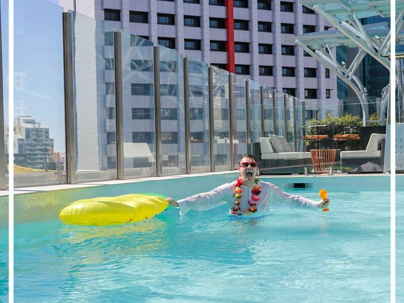 Man swimming at Pullman & Mercure Brisbane King George Square