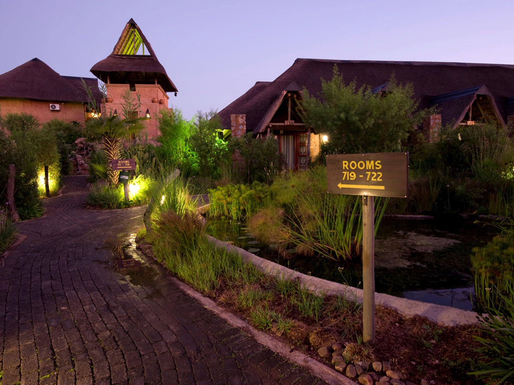 Landscape of path leading to rooms at dusk