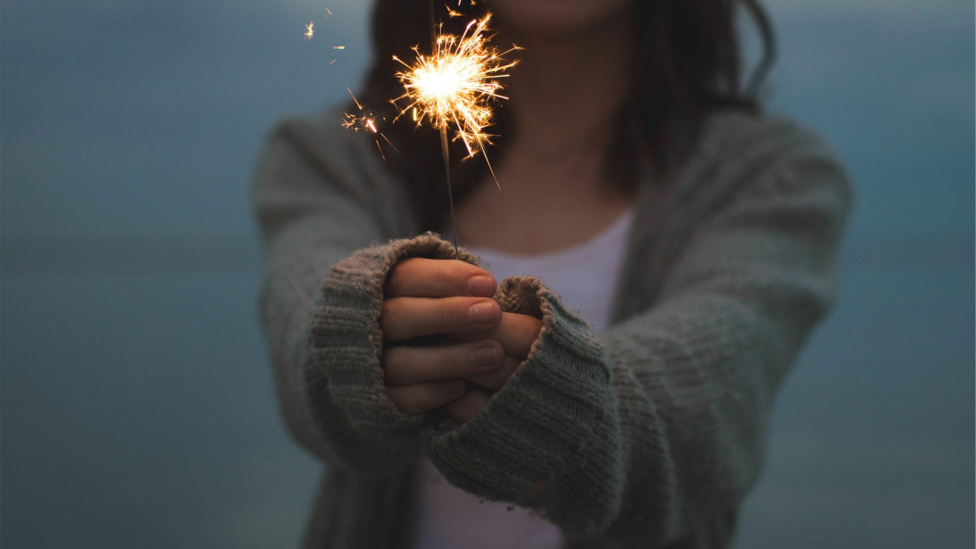 Girl celebrating with a Firecracker