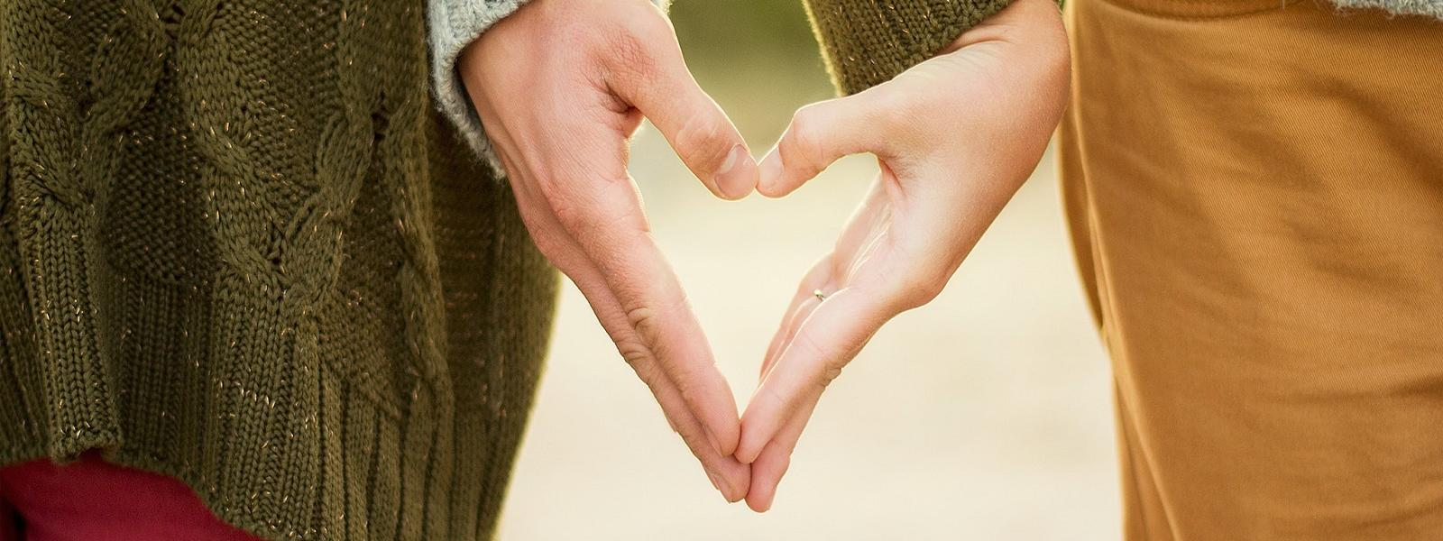 Couple holding hands heart shaped