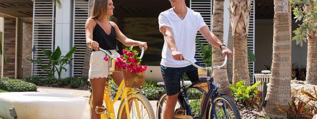 Couple Bicycling at Warwick Paradise Island Bahamas