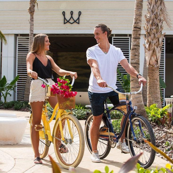 Couple Bicycling at Warwick Paradise Island Bahamas