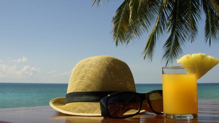 Beach view and cocktail at Naviti Resort Fiji