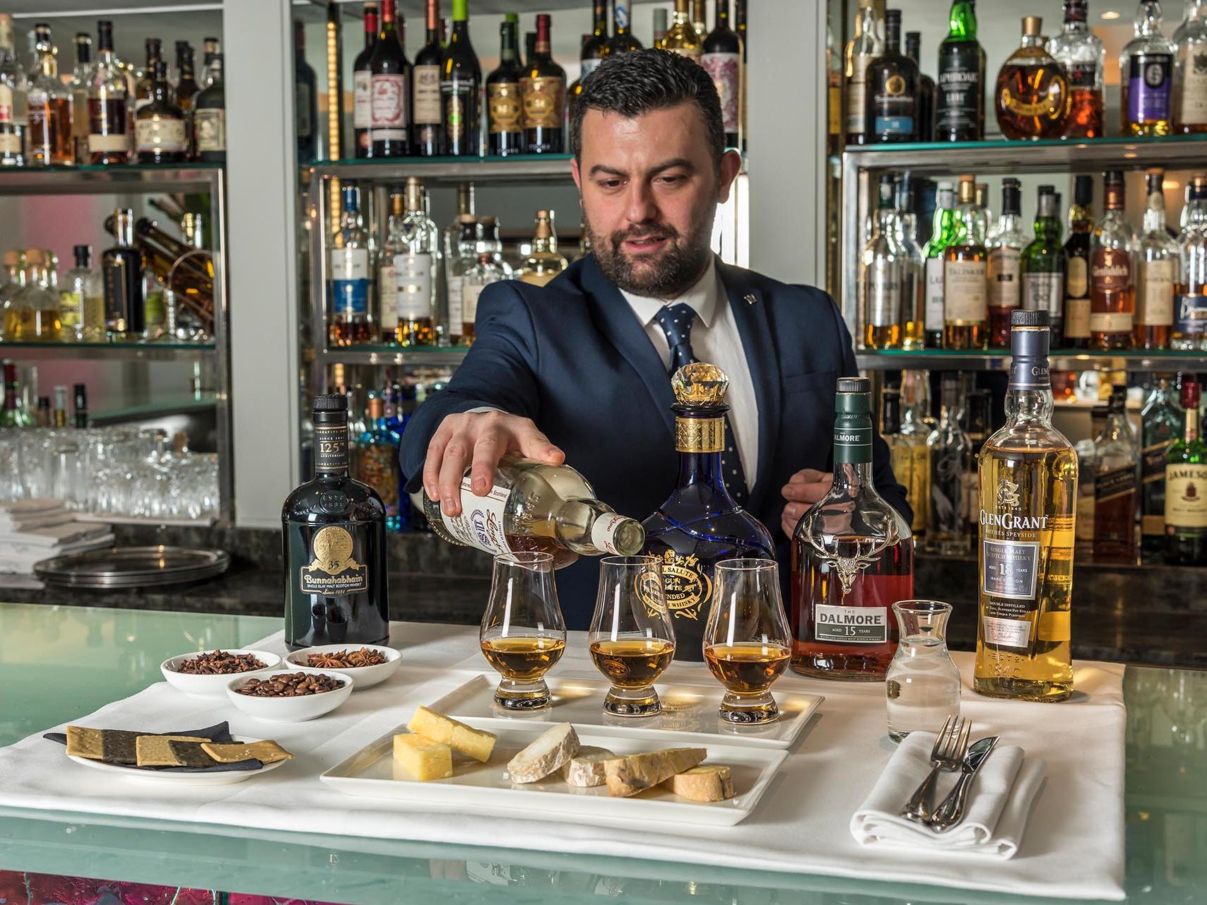 Whisky and Cheese Barman at The Capital by Warwick