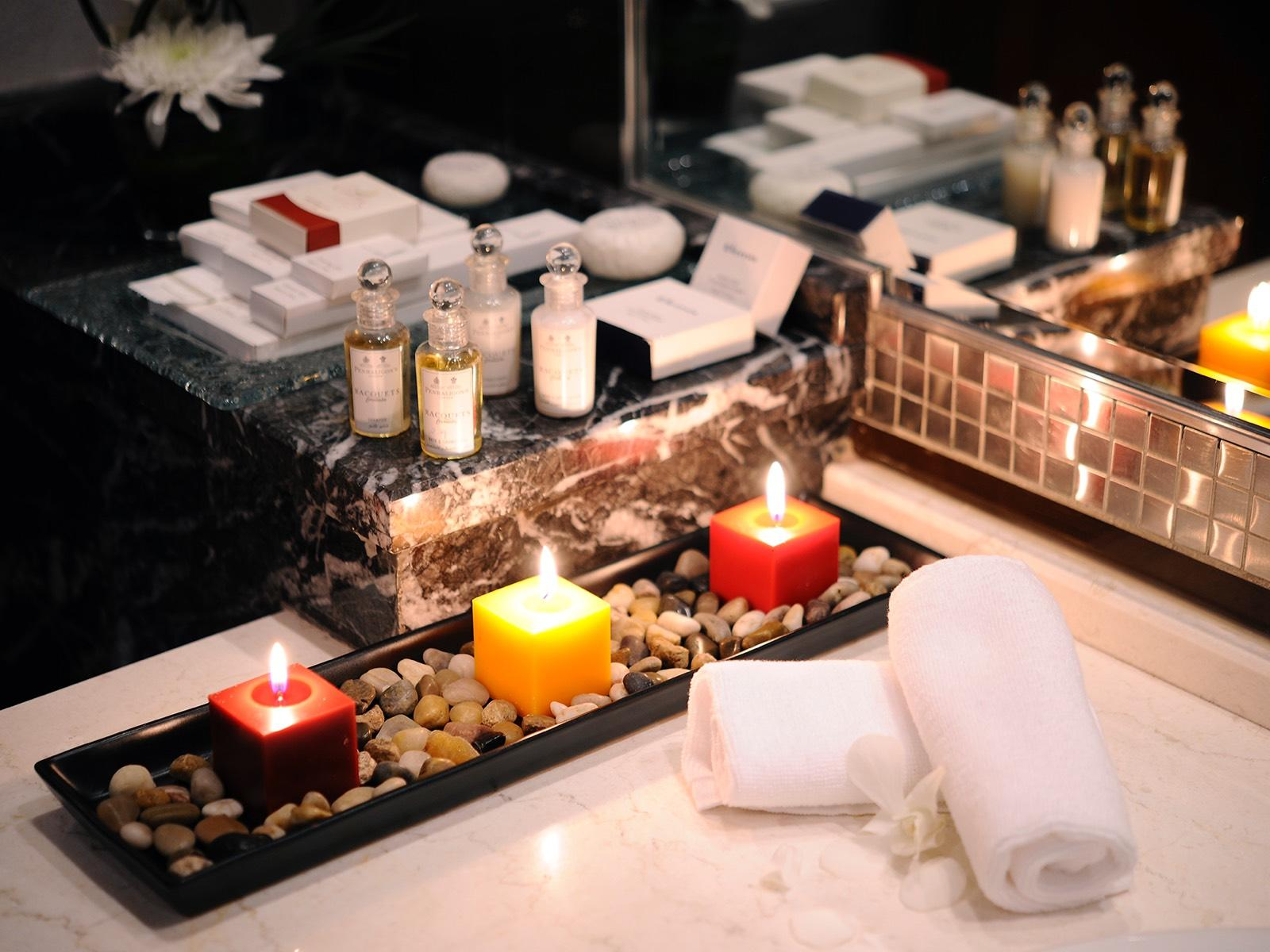 Bathroom close-up candles at Junior Suite at Al Hamra Palace by Warwick